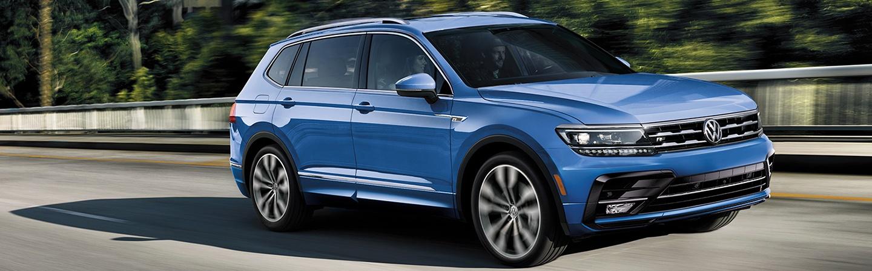 Blue 2020 Volkswagen Tiguan driving - Side