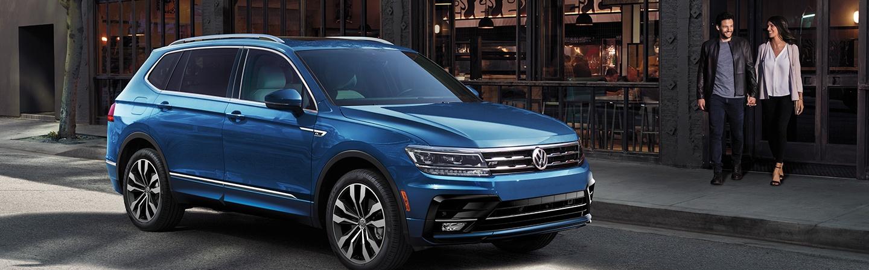 Blue 2020 Volkswagen Tiguan parked - Side