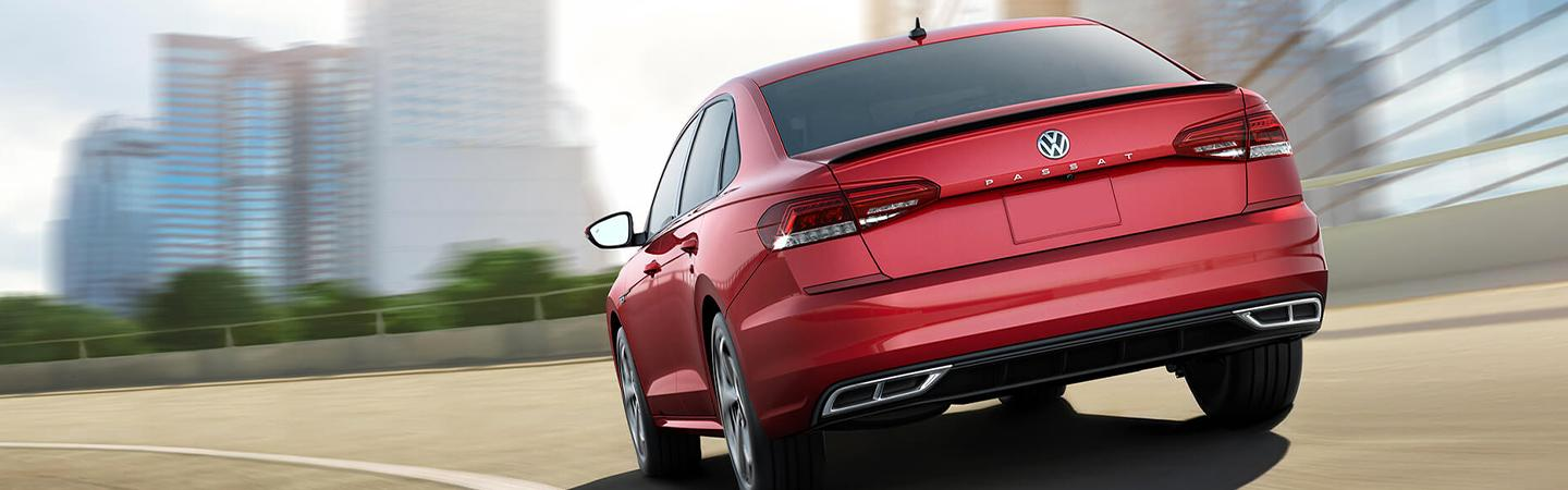 Red 2020 Volkswagen Passat Driving - Rear