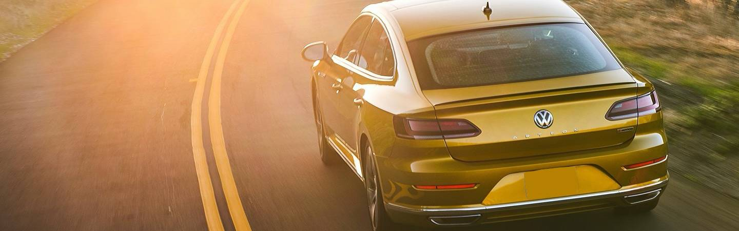 Rear view of the 2019 Volkswagen Arteon driving in the sun