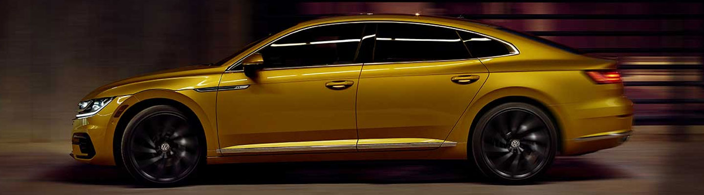 Side view of the 2019 Volkswagen Arteon parked outside