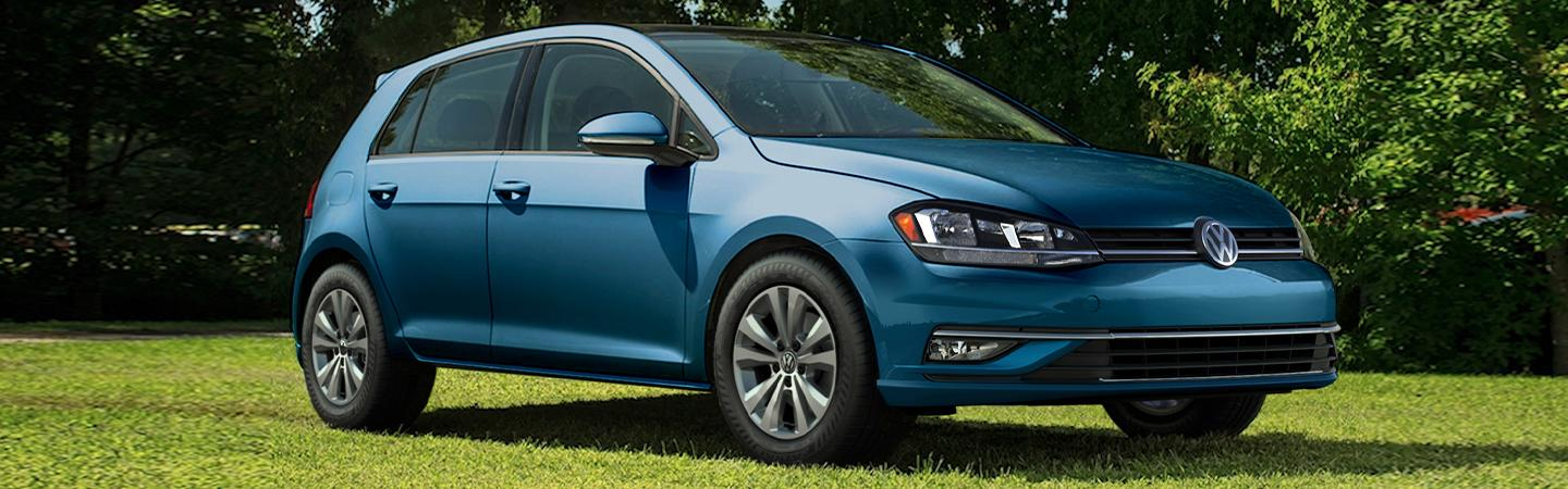Side view of the 2019 Volkswagen Golf parked in a field