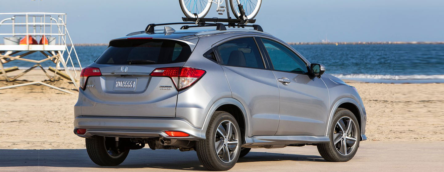 2019 Honda HR-V parked at the beach with bike on top rack.