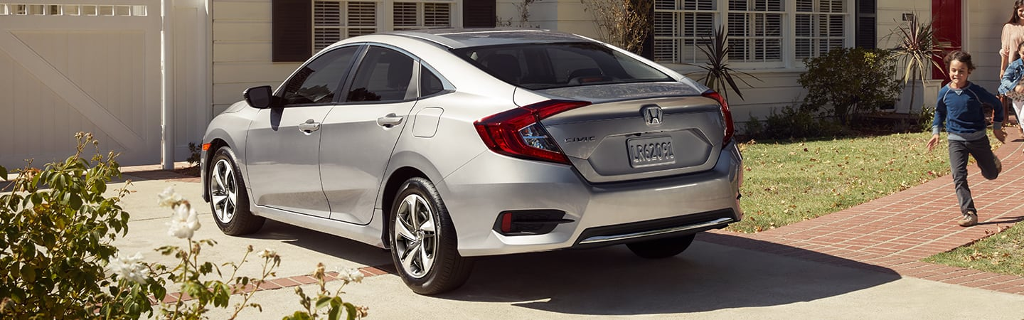 Rear view of the 2020 Honda Civic parked at a house
