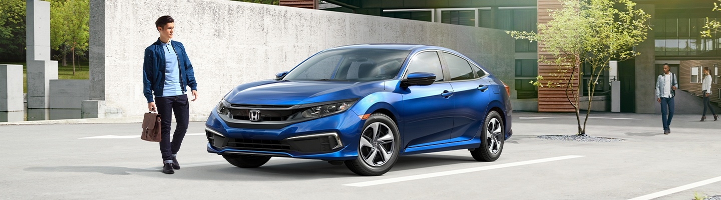 Front view of the 2020 Honda Civic parked on the side of the road.