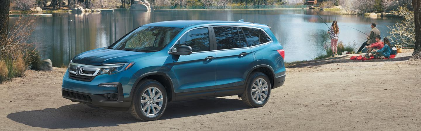 Blue 2020 Honda Pilot parked by the water