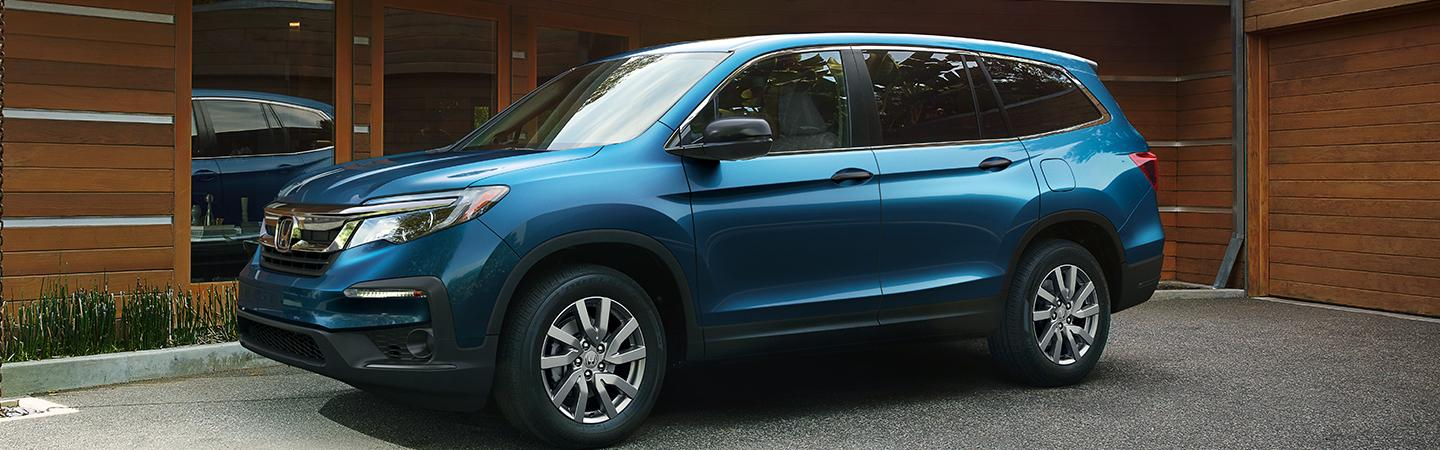 Blue 2020 Honda Pilot parked in a driveway