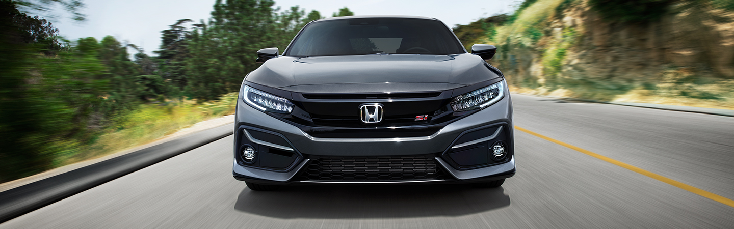 Front view of a grey 2021 Honda Civic in motion