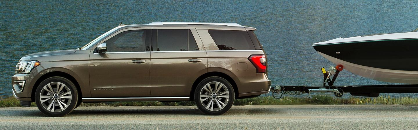 Side view of the 2020 Ford Expedition towing a boat
