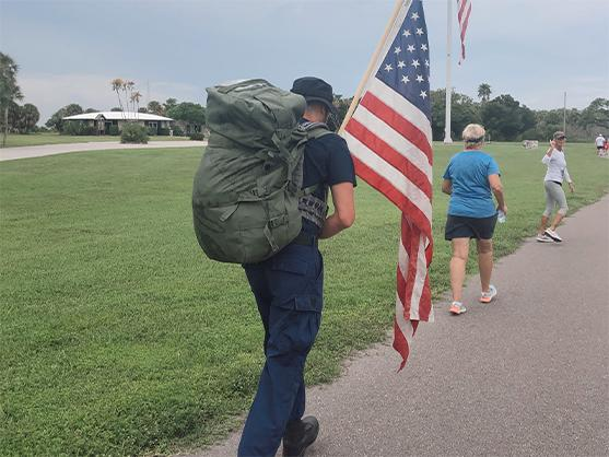 Perople walking at A Run To Honor Vets & The Victims Of 9/11