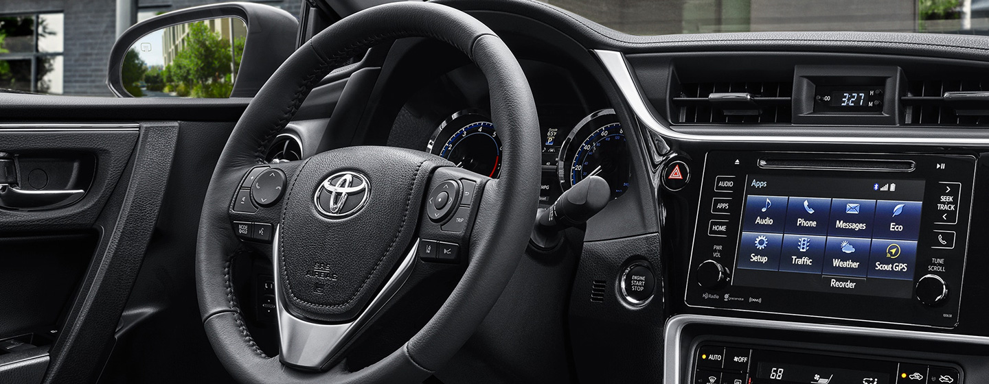 Safety features and interior of the 2019 Toyota Corolla for sale at our Toyota dealership near Wesley Chapel, Brandon.