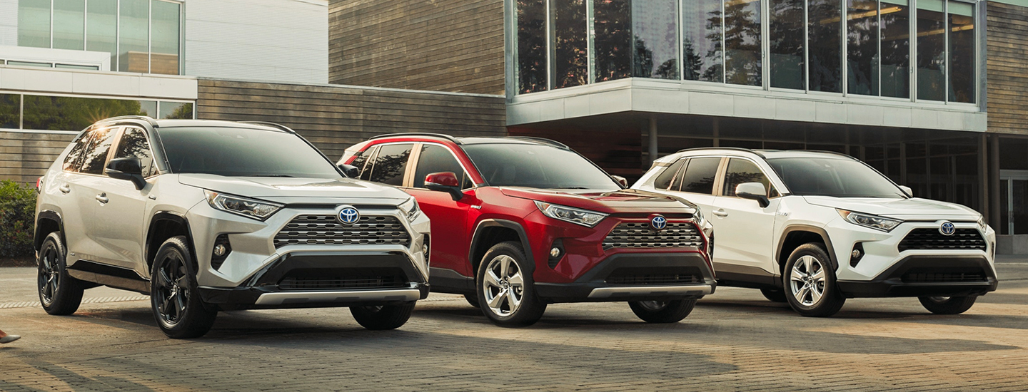 Side view of three different 2021 Toyota RAV4s parked together