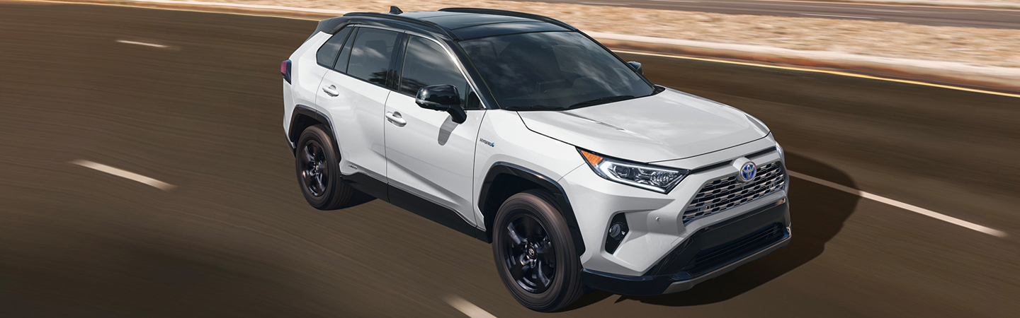 Overview of a white 2021 Toyota RAV4 in motion