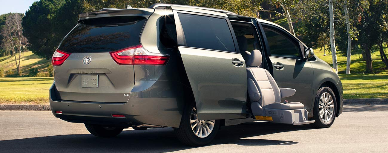 2019 Toyota Sienna parked with passenger chair deployed out for easy loading in the city